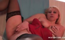 Slutty blonde mature finger fucking her peachy cunt